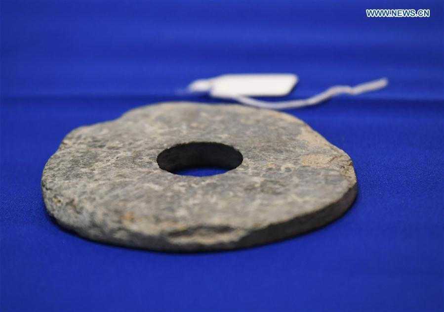 Photo taken on Feb. 28, 2019 shows a jade disc during a repatriation event held in the Eiteljorg Museum of Indianapolis, capital city of state of Indiana, the United States. The United States announced the repatriation of 361 pieces of Chinese relics and artifacts to China at a ceremony on Thursday. (Xinhua/Liu Jie)