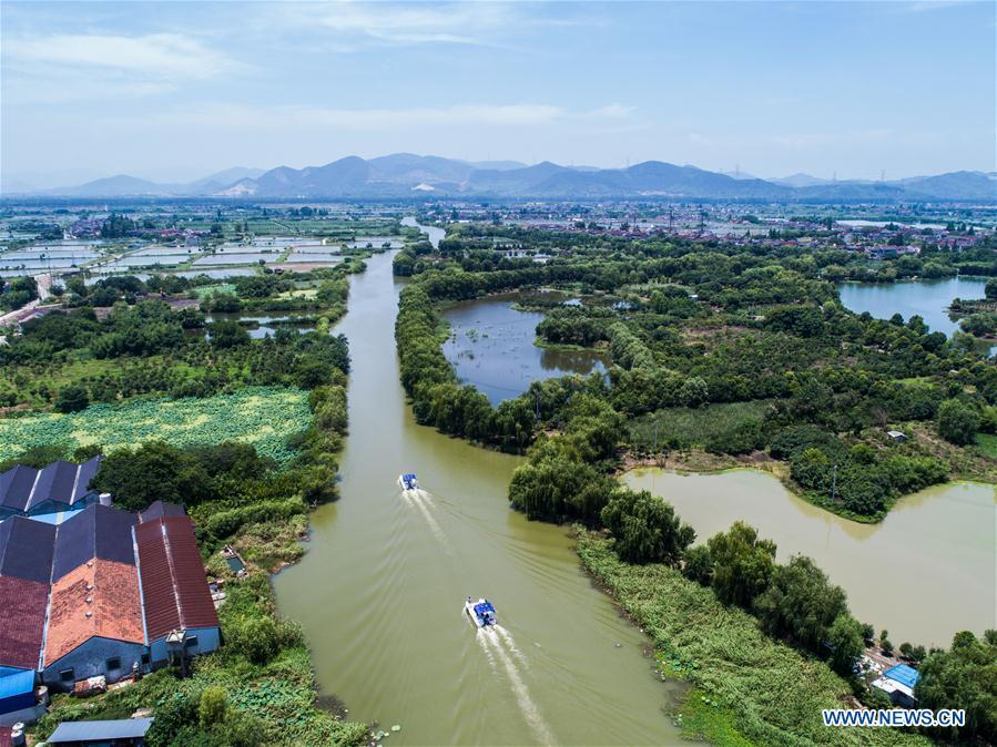 Aerial photo taken on July 10, 2018 shows river chief and other staff members patrolling on a river at Baojian Village of Huzhou City, east China\'s Zhejiang Province. As \