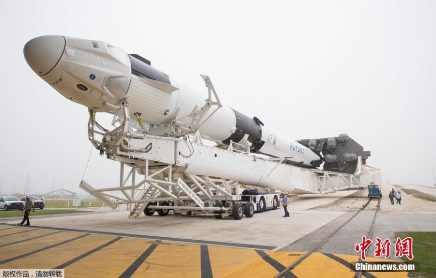 A SpaceX Falcon 9 rocket with the company\'s Crew Dragon spacecraft onboard is seen as it is rolled to the launch pad at Launch Complex 39A as preparations continue for the Demo-1 mission, Feb. 28, 2019 at NASA\'s Kennedy Space Center in Florida. The Demo-1 mission will be the first launch of a commercially built and operated American spacecraft and space system designed for humans as part of NASA\'s Commercial Crew Program. (Photo/Agencies)