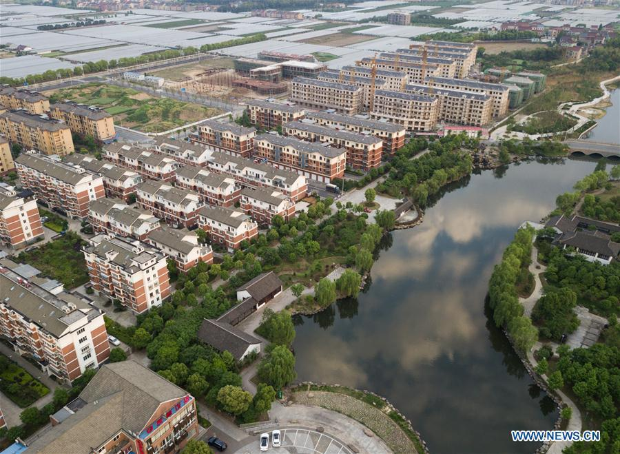 Aerial photo taken on April 21, 2018 shows the view of Xinye Village of Shaoxing City, east China\'s Zhejiang Province. As \