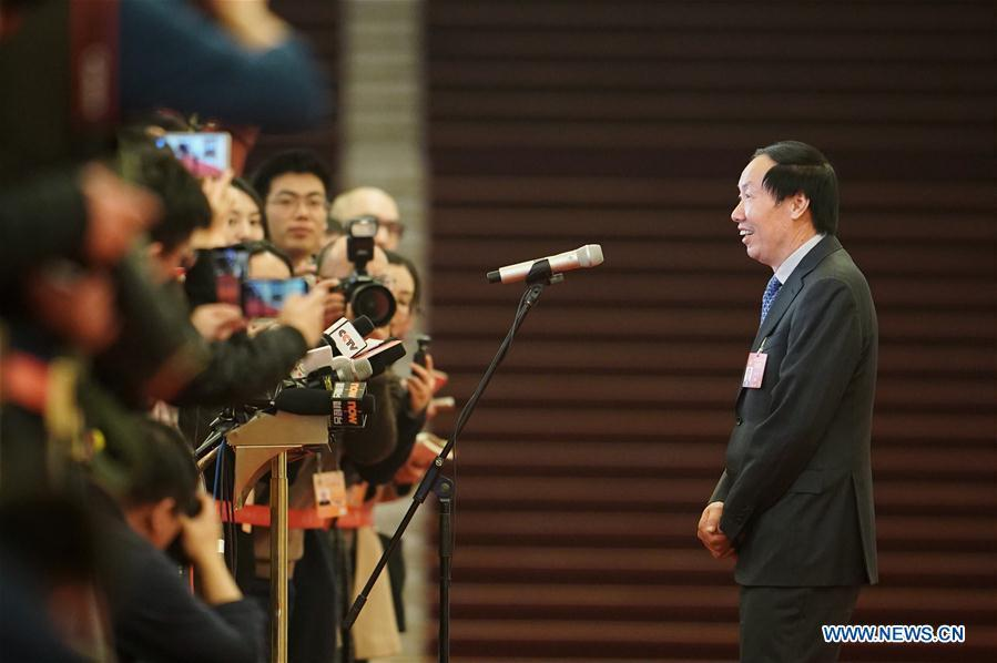 Liu Yuzhu, head of the National Cultural Heritage Administration, receives an interview after the opening meeting of the second session of the 13th National Committee of the Chinese People\'s Political Consultative Conference (CPPCC) at the Great Hall of the People in Beijing, capital of China, March 3, 2019. (Xinhua/Shen Bohan)