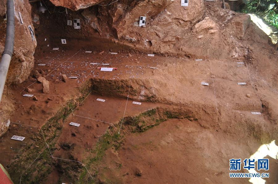 An excavation at the Longquan Cave, an early Upper Paleolithic site in Central China\'s Henan Province. Archeologists have found remains of ash and fire pits in the cave, evidence of the use of fires some 40,000 years ago. The discovery was selected as a top archaeological finding in 2018 in the province. (Photo/Xinhua)