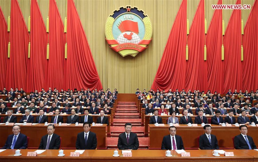 Xi Jinping (C, front), Li Keqiang (3rd R, front), Li Zhanshu (3rd L, front), Wang Huning (2nd R, front), Zhao Leji (2nd L, front), Han Zheng (1st R, front), and Wang Qishan (1st L, front) attend the opening meeting of the second session of the 13th National Committee of the Chinese People\'s Political Consultative Conference at the Great Hall of the People in Beijing, capital of China, March 3, 2019. (Xinhua/Ju Peng)