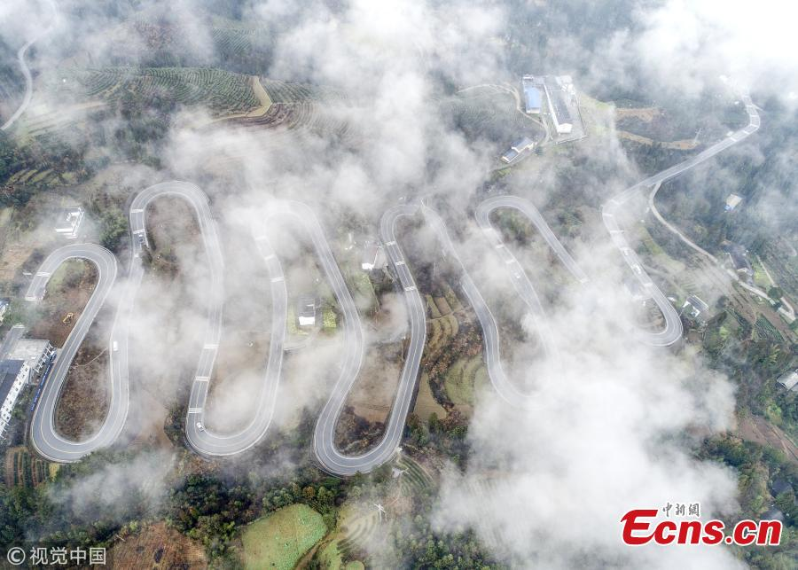 A winding mountain road, which has become a tourist attraction for its ten bends, is shrouded in mist in Taiyanghe Township, Enshi Tujia and Miao Autonomous Prefecture, Hubei Province, March 3, 2019. (Photo/VCG)