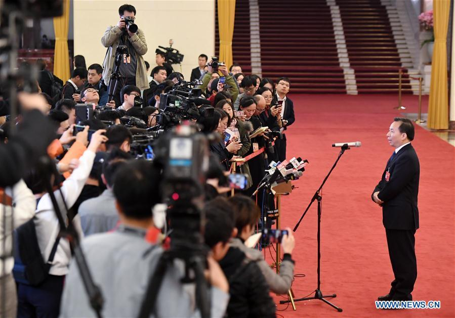Li Ganjie, minister of ecology and environment, receives an interview after the opening meeting of the second session of the 13th National Committee of the Chinese People\'s Political Consultative Conference (CPPCC) at the Great Hall of the People in Beijing, capital of China, March 3, 2019. (Xinhua/Shen Bohan)