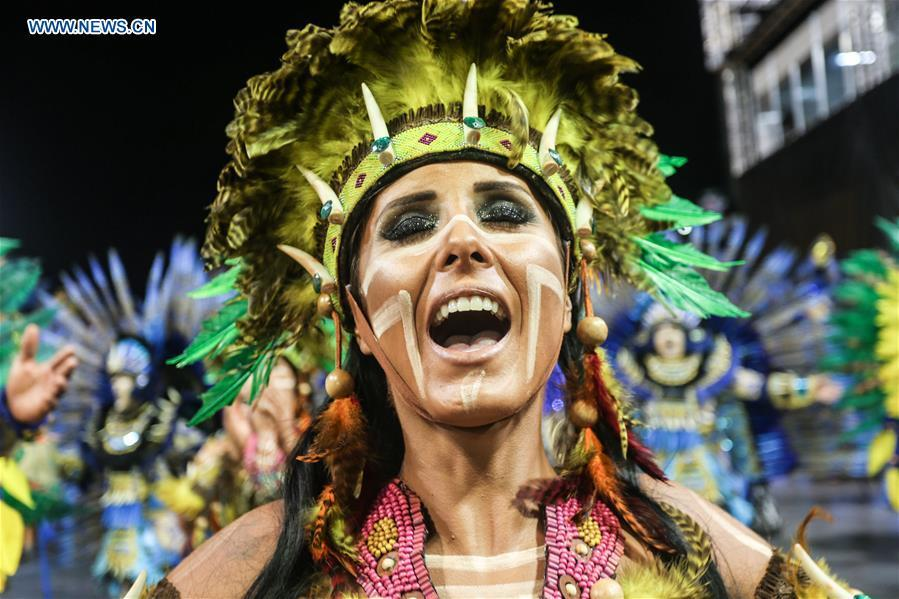 A reveller from a samba school performs during the carnival parade in Sao Paulo, Brazil, March 2, 2019. (Xinhua/Rahel Patrasso)