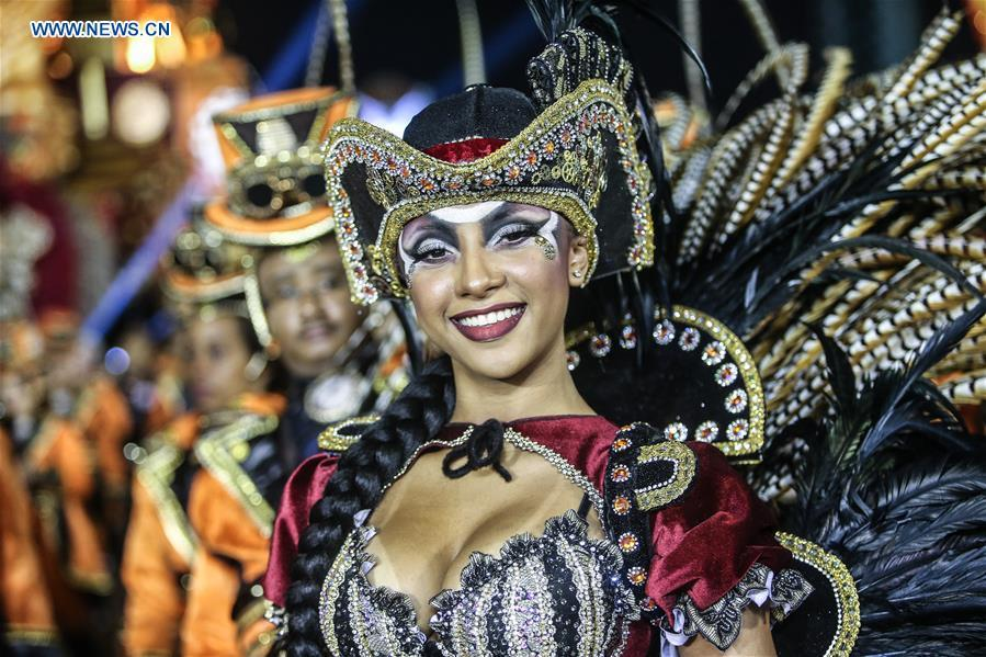 A reveller from a samba school performs during the carnival parade in Sao Paulo, Brazil, March 3, 2019. (Xinhua/Rahel Patrasso)