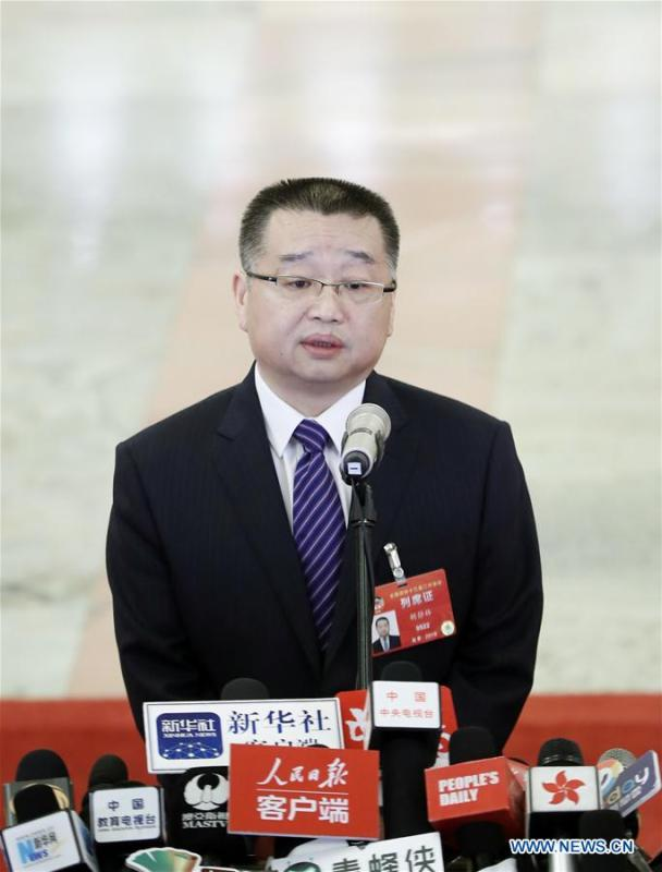 Hu Jinglin, head of the National Healthcare Security Administration, receives an interview after the opening meeting of the second session of the 13th National Committee of the Chinese People\'s Political Consultative Conference (CPPCC) at the Great Hall of the People in Beijing, capital of China, March 3, 2019. (Xinhua/Cai Yang)