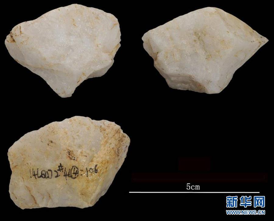 Stone relics excavated at the Longquan Cave, an early Upper Paleolithic site in Central China\'s Henan Province. Archeologists have found remains of ash and fire pits in the cave, evidence of the use of fires some 40,000 years ago. The discovery was selected as a top archaeological finding in 2018 in the province. (Photo/Xinhua)