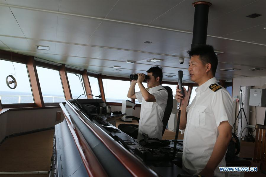 Photo taken on March 3, 2019 shows the captain (R) and the pilot working aboard China\'s research icebreaker Xuelong. Xuelong, carrying members of China\'s 35th research mission to Antarctica, crossed the equator and returned to the Northern Hemisphere on early Monday morning. (Xinhua/Liu Shiping)