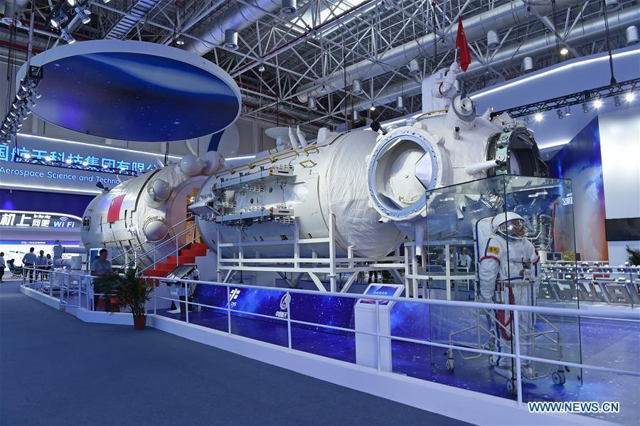 Photo taken on Nov. 5, 2018 shows a full-size model of the core module of China\'s space station Tianhe exhibited at the 12th China International Aviation and Aerospace Exhibition (Airshow China) in Zhuhai, south China\'s Guangdong Province. The China Manned Space Engineering Office (CMSEO) announced Monday that the core module of the country\'s space station, the Long March-5B carrier rocket and its payloads will be sent to the launch site in the second half of this year, to make preparations for the space station missions. China is scheduled to complete the construction of the space station around 2022. It will be the country\'s space lab in long-term stable in-orbit operation. (Xinhua/Liang Xu)