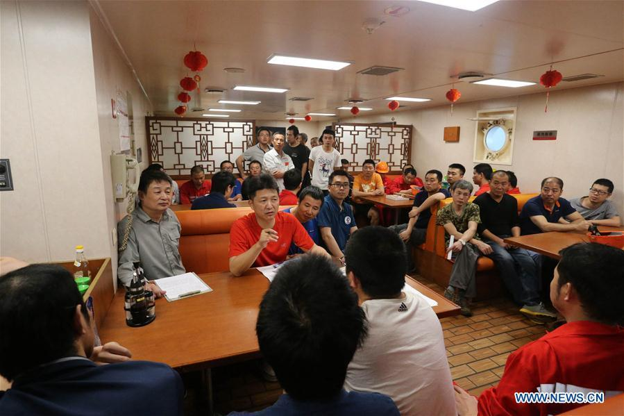 Photo taken on March 1, 2019 shows crew members holding a meeting aboard China\'s research icebreaker Xuelong. Xuelong, carrying members of China\'s 35th research mission to Antarctica, crossed the equator and returned to the Northern Hemisphere on early Monday morning. (Xinhua/Liu Shiping)
