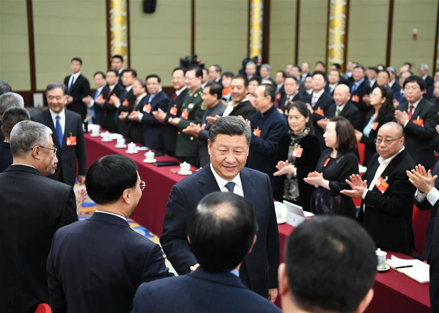 Chinese President Xi Jinping, also general secretary of the Communist Party of China (CPC) Central Committee and chairman of the Central Military Commission, visits political advisors from the sectors of culture and art, and social sciences who are attending the second session of the 13th National Committee of the Chinese People\'s Political Consultative Conference (CPPCC) in Beijing, capital of China, March 4, 2019. Xi joined them in a joint panel discussion and heard their opinions and suggestions. Wang Yang, a member of the Standing Committee of the Political Bureau of the CPC Central Committee and chairman of the CPPCC National Committee, also attended the discussion. (Xinhua/Xie Huanchi)