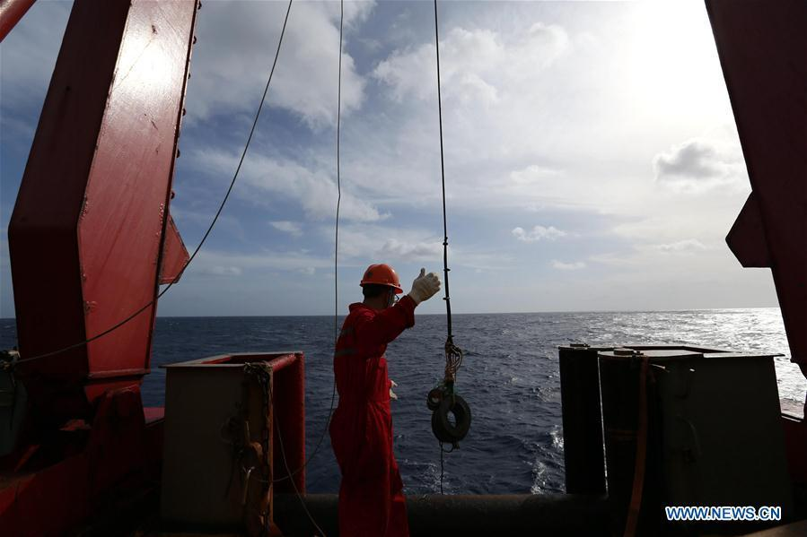 Photo taken on Feb. 28, 2019 shows a crew member maintaining the equipment aboard China\'s research icebreaker Xuelong. Xuelong, carrying members of China\'s 35th research mission to Antarctica, crossed the equator and returned to the Northern Hemisphere on early Monday morning. (Xinhua/Liu Shiping)