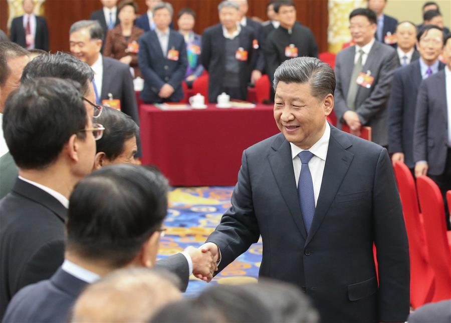 Chinese President Xi Jinping, also general secretary of the Communist Party of China (CPC) Central Committee and chairman of the Central Military Commission, visits political advisors from the sectors of culture and art, and social sciences who are attending the second session of the 13th National Committee of the Chinese People\'s Political Consultative Conference (CPPCC) in Beijing, capital of China, March 4, 2019. Xi joined them in a joint panel discussion and heard their opinions and suggestions. Wang Yang, a member of the Standing Committee of the Political Bureau of the CPC Central Committee and chairman of the CPPCC National Committee, also attended the discussion. (Xinhua/Yao Dawei)