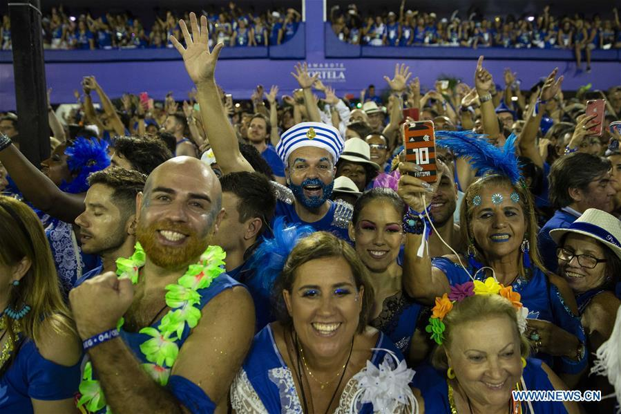 The audience react during the parades of the Rio Carnival 2019 at the Sambadrome in Rio de Janeiro, Brazil, on March 5, 2019. The parade of the special group samba school concluded on Tuesday. (Xinhua/Li Ming)