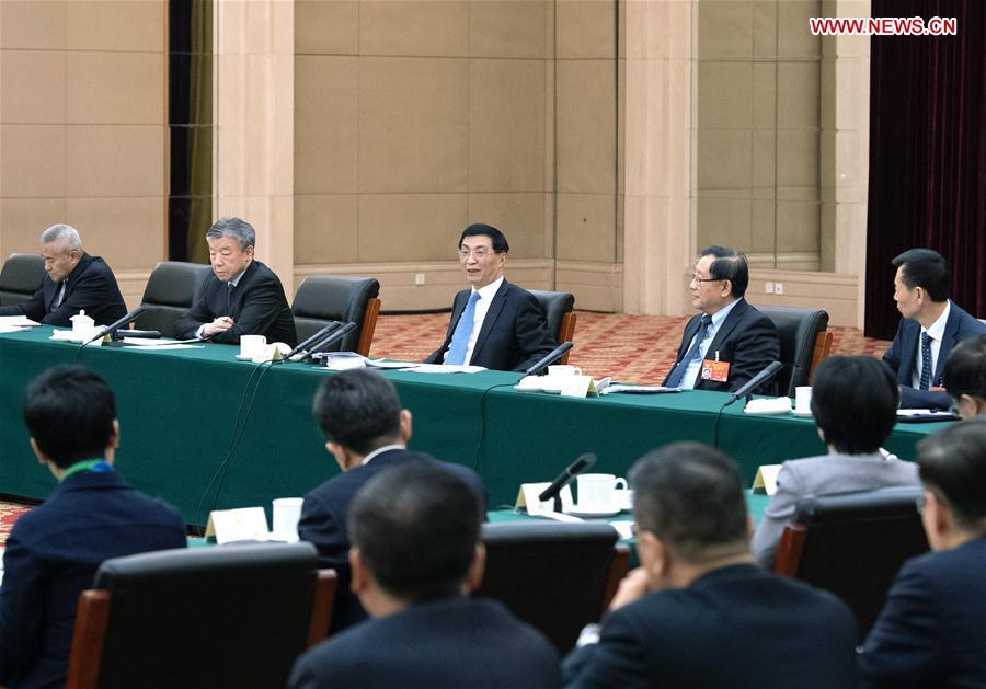 Wang Huning, a member of the Standing Committee of the Political Bureau of the Communist Party of China (CPC) Central Committee and a member of the Secretariat of the CPC Central Committee, joins a panel discussion with political advisors from the sectors of social welfare and security and specially invited political advisors at the second session of the 13th National Committee of the Chinese People\'s Political Consultative Conference (CPPCC) in Beijing, capital of China, March 4, 2019. (Xinhua/Shen Hong)
