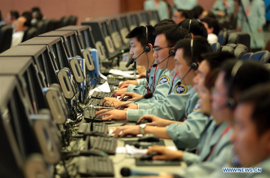 Technicians work at the Beijing Aerospace Control Center (BACC) in Beijing, capital of China, Nov. 18, 2016. The China Manned Space Engineering Office (CMSEO) announced Monday that the core module of the country\'s space station, the Long March-5B carrier rocket and its payloads will be sent to the launch site in the second half of this year, to make preparations for the space station missions. China is scheduled to complete the construction of the space station around 2022. It will be the country\'s space lab in long-term stable in-orbit operation. (Xinhua/Cai Yang)