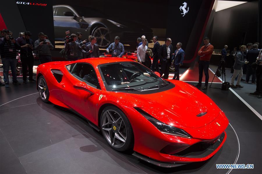A new Ferrari F8 Tributo is seen on the first press day of the 89th Geneva International Motor Show in Geneva, Switzerland, March 5, 2019. Featuring about 220 world exhibitors, the 89th Geneva International Motor Show will be opened to the public from March 7 to 17. (Xinhua/Xu Jinquan)