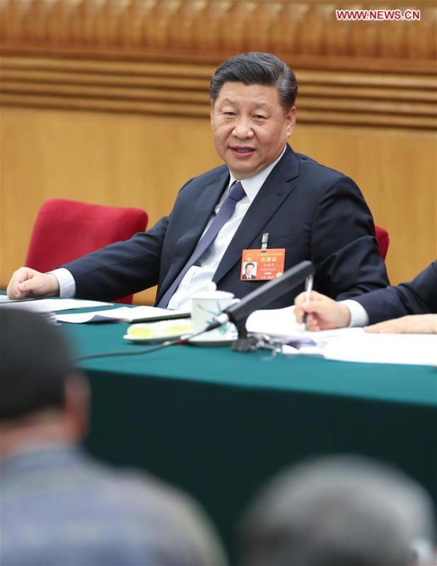 Chinese President Xi Jinping, also general secretary of the Communist Party of China (CPC) Central Committee and chairman of the Central Military Commission, attends a panel discussion with his fellow deputies from Inner Mongolia Autonomous Region at the second session of the 13th National People\'s Congress in Beijing, capital of China, March 5, 2019. (Xinhua/Huang Jingwen)