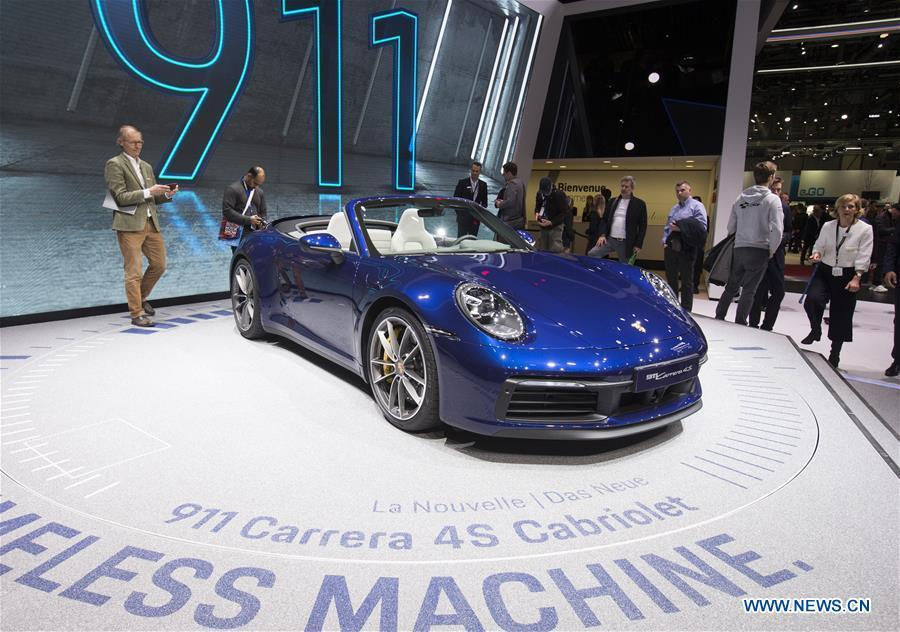 A Porsche 911 Carrera 4S Cabriolet is seen on the first press day of the 89th Geneva International Motor Show in Geneva, Switzerland, March 5, 2019. Featuring about 220 world exhibitors, the 89th Geneva International Motor Show will be opened to the public from March 7 to 17. (Xinhua/Xu Jinquan)