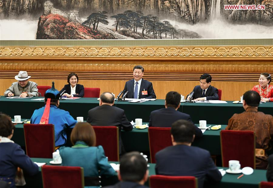 Chinese President Xi Jinping, also general secretary of the Communist Party of China (CPC) Central Committee and chairman of the Central Military Commission, attends a panel discussion with his fellow deputies from Inner Mongolia Autonomous Region at the second session of the 13th National People\'s Congress in Beijing, capital of China, March 5, 2019. (Xinhua/Xie Huanchi)