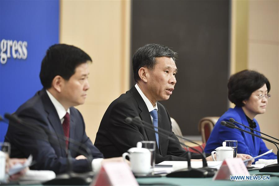 China\'s Minister of Finance Liu Kun (C) answers questions at a press conference on the country\'s fiscal and tax reforms and fiscal work for the second session of the 13th National People\'s Congress in Beijing, capital of China, March 7, 2019. (Xinhua/Li Ran)