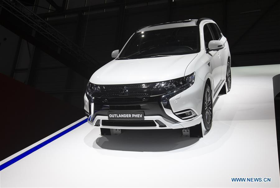 Photo taken on March 6, 2019 shows the new Mitsubishi Outlander PHEV at the 89th Geneva International Motor Show in Geneva, Switzerland. Electric cars and hybrid cars are highlights at this year\'s Geneva International Motor Show, which will open to the public from March 7 to 17. (Xinhua/Xu Jinquan)