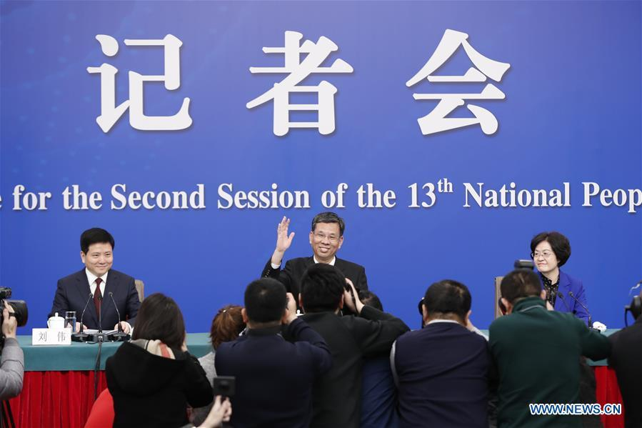 China\'s Minister of Finance Liu Kun (C), and vice ministers Cheng Lihua (R) and Liu Wei attend a press conference on the country\'s fiscal and tax reforms and fiscal work for the second session of the 13th National People\'s Congress in Beijing, capital of China, March 7, 2019. (Xinhua/Shen Bohan)