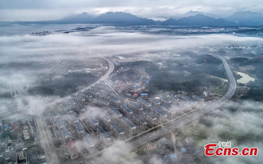 A drone photo taken on March 5, 2019 shows the skyline of Wuning County in Jiangxi Province under heavy fog. (Photo: China News Service/Luo Xingang)
