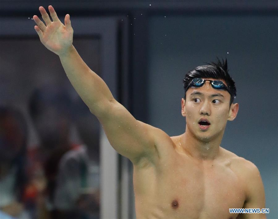 Ning Zetao of Henan reacts after the men\'s 100m freestyle swimming final at 13th Chinese National Games in North China\'s Tianjin, Sept. 4, 2017. Ning Zetao claimed the title with 47.92 seconds. (Photo/Xinhua)