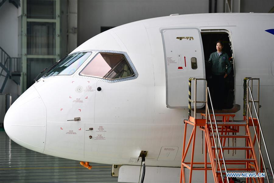 Jiang Dandan walks out of a flight-testing aircraft in Yanliang District of Xi\'an, capital of northwest China\'s Shaanxi Province, on March 5, 2019. Jiang Dandan, 29, is one of the youngest test pilots in China and the only female test pilot for commercial transport aircrafts currently being trained at the Aviation Industry Corporation of China, Ltd. She went through dozens of professional courses and 750 hours of flying practice in six years. At the end of 2017, she became a test pilot and participated in the test flights during the research and development of ARJ21-700, C919 and other types of aircrafts. (Xinhua/Shao Rui)