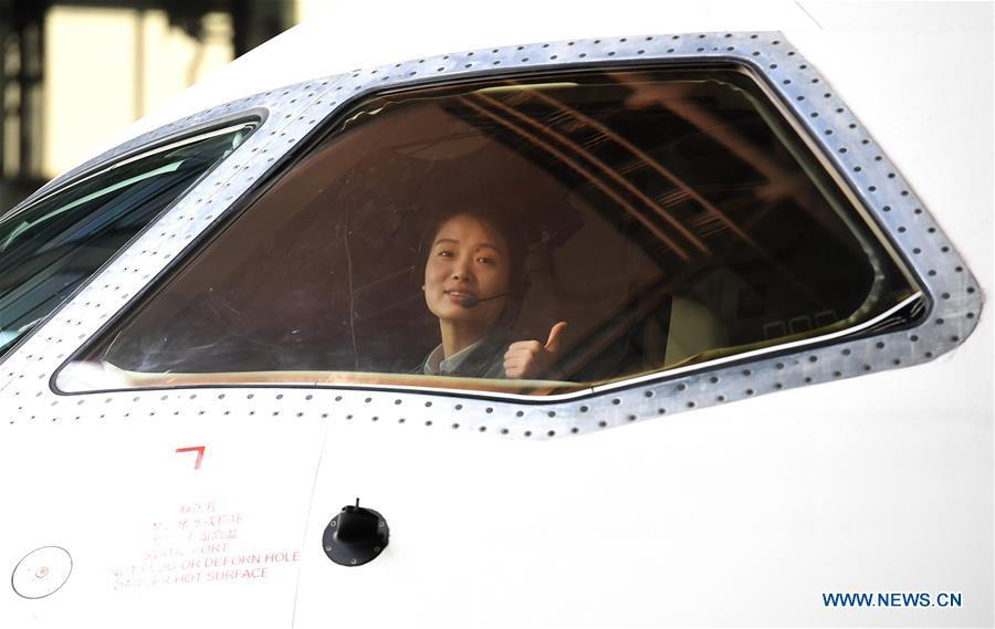 Jiang Dandan is seen in the cockpit of a flight-testing aircraft in Yanliang District of Xi\'an, capital of northwest China\'s Shaanxi Province, on March 5, 2019. Jiang Dandan, 29, is one of the youngest test pilots in China and the only female test pilot for commercial transport aircrafts currently being trained at the Aviation Industry Corporation of China, Ltd. She went through dozens of professional courses and 750 hours of flying practice in six years. At the end of 2017, she became a test pilot and participated in the test flights during the research and development of ARJ21-700, C919 and other types of aircrafts. (Xinhua/Liu Xiao)