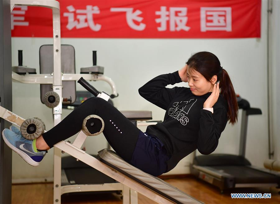 Jiang Dandan exercises at a physical training center for flight tester in Yanliang District of Xi\'an, capital of northwest China\'s Shaanxi Province, on March 5, 2019. Jiang Dandan, 29, is one of the youngest test pilots in China and the only female test pilot for commercial transport aircrafts currently being trained at the Aviation Industry Corporation of China, Ltd. She went through dozens of professional courses and 750 hours of flying practice in six years. At the end of 2017, she became a test pilot and participated in the test flights during the research and development of ARJ21-700, C919 and other types of aircrafts. (Xinhua/Shao Rui)