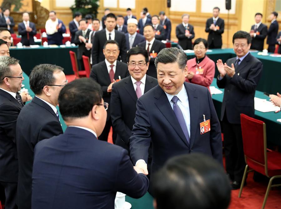 Chinese President Xi Jinping, also general secretary of the Communist Party of China (CPC) Central Committee and chairman of the Central Military Commission, joins deliberation with deputies from Gansu Province at the second session of the 13th National People\'s Congress in Beijing, capital of China, March 7, 2019. (Xinhua/Ju Peng)