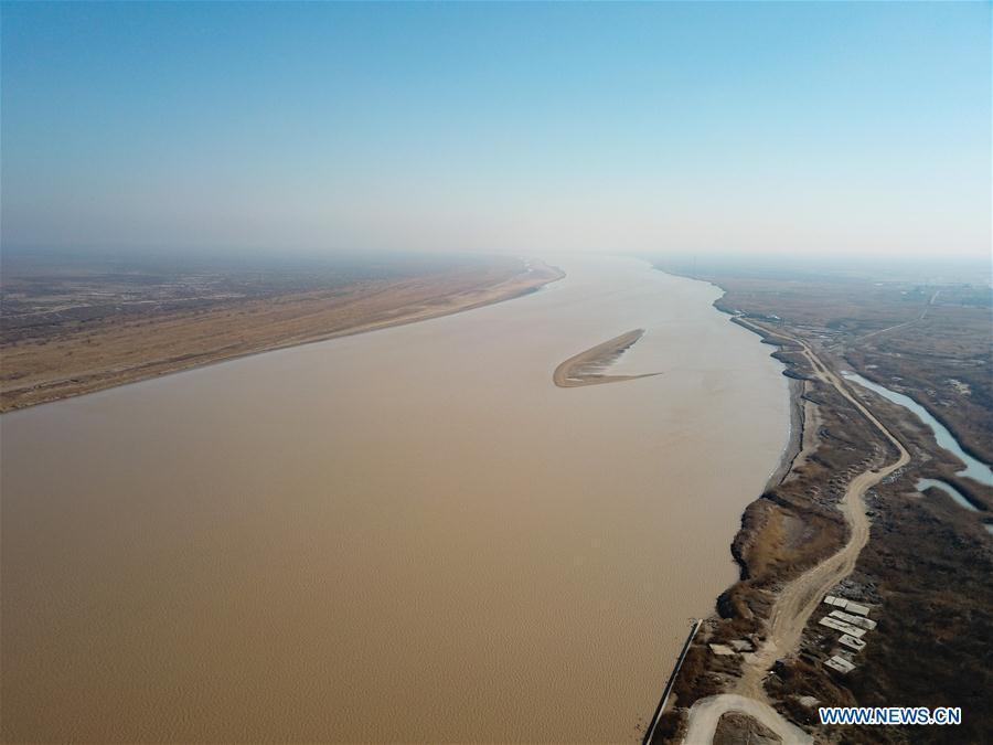 Aerial photo taken on March 7, 2019 shows the view of the Yellow River Delta national natural reserve in Dongying, east China\'s Shandong Province. The Yellow River Delta national natural reserve lies in Dongying City, from where the Yellow River empties itself into the Bohai Sea. In recent years, the natural reserve has been making efforts to protect ecological diversity and restore wetland in order to promote a harmonious coexistence between man and nature. (Xinhua/Wang Nan)