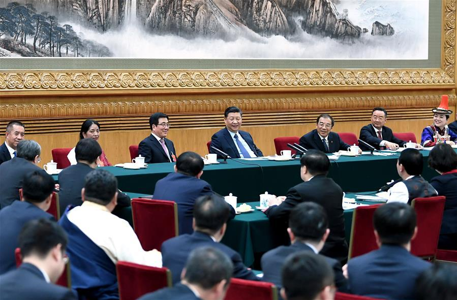 Chinese President Xi Jinping, also general secretary of the Communist Party of China (CPC) Central Committee and chairman of the Central Military Commission, joins deliberation with deputies from Gansu Province at the second session of the 13th National People\'s Congress in Beijing, capital of China, March 7, 2019. (Xinhua/Xie Huanchi)