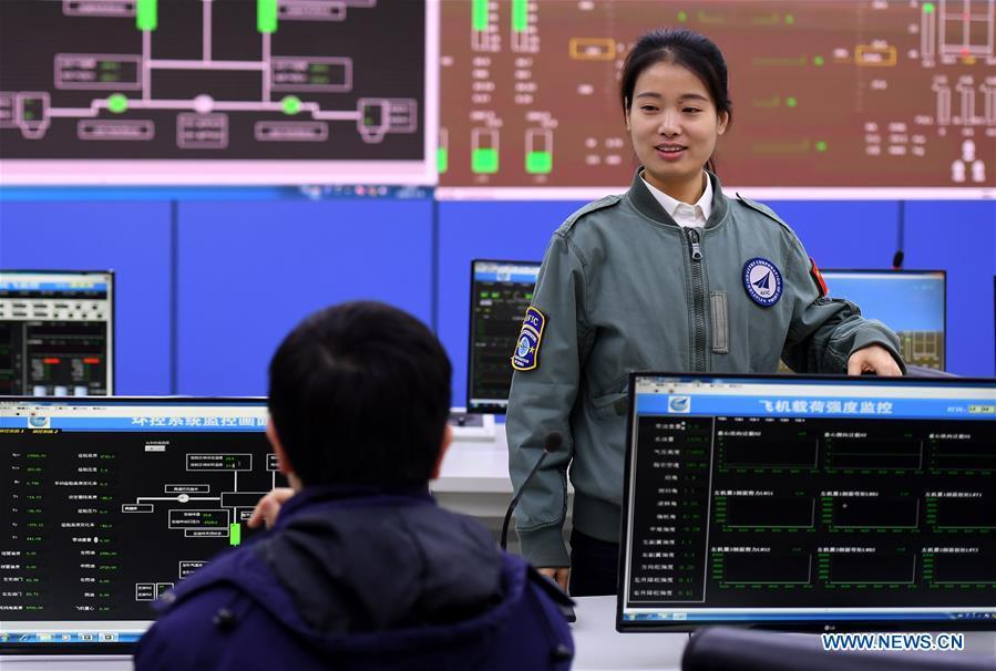Jiang Dandan communicates with a colleague about the flight-test affairs in Yanliang District of Xi\'an, capital of northwest China\'s Shaanxi Province, on March 6, 2019. Jiang Dandan, 29, is one of the youngest test pilots in China and the only female test pilot for commercial transport aircrafts currently being trained at the Aviation Industry Corporation of China, Ltd. She went through dozens of professional courses and 750 hours of flying practice in six years. At the end of 2017, she became a test pilot and participated in the test flights during the research and development of ARJ21-700, C919 and other types of aircrafts. (Xinhua/Liu Xiao)