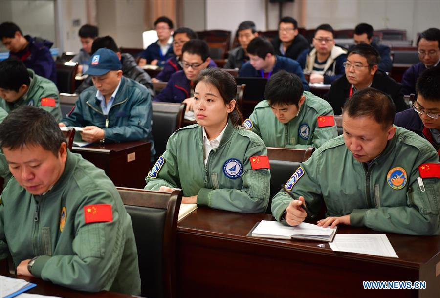 Jiang Dandan (C) takes part in a flight mission coordinating meeting in Yanliang District of Xi\'an, capital of northwest China\'s Shaanxi Province, on March 6, 2019. Jiang Dandan, 29, is one of the youngest test pilots in China and the only female test pilot for commercial transport aircrafts currently being trained at the Aviation Industry Corporation of China, Ltd. She went through dozens of professional courses and 750 hours of flying practice in six years. At the end of 2017, she became a test pilot and participated in the test flights during the research and development of ARJ21-700, C919 and other types of aircrafts. (Xinhua/Shao Rui)