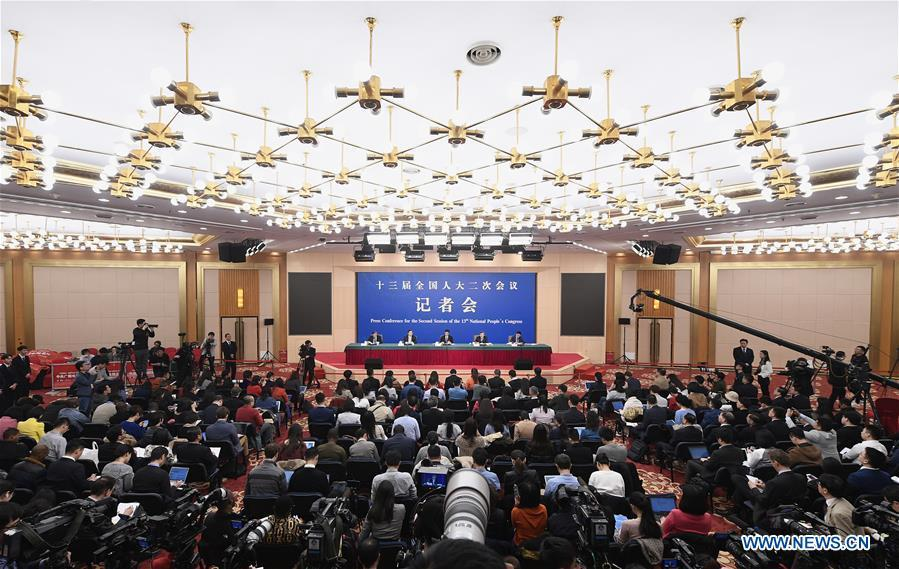 China\'s Minister of Commerce Zhong Shan, Vice Minister of Commerce and Deputy China International Trade Representative Wang Shouwen and Vice Minister of Commerce Qian Keming attend a press conference on China\'s domestic market and all-round opening-up for the second session of the 13th National People\'s Congress (NPC) in Beijing, capital of China, March 9, 2019. (Xinhua/Wang Peng)