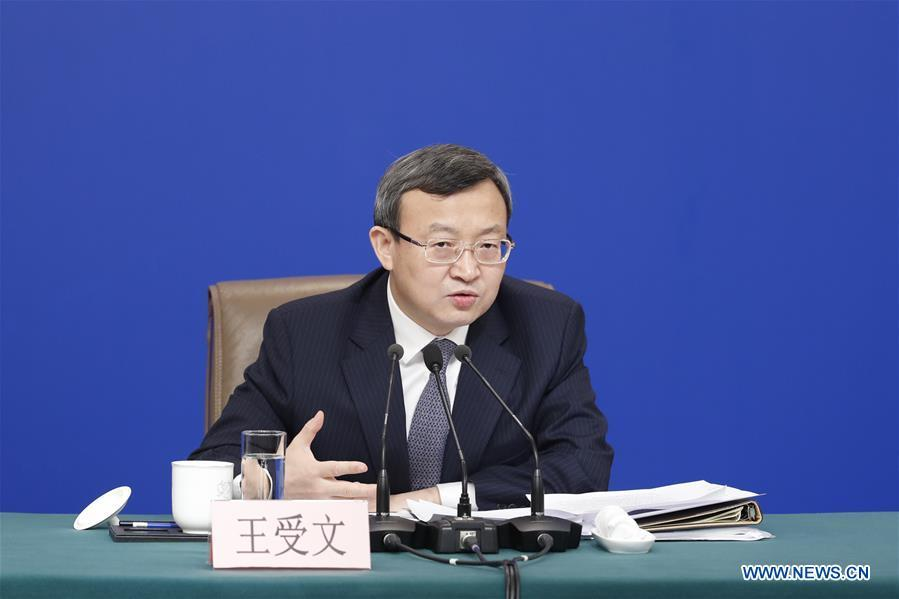 Vice Minister of Commerce and Deputy China International Trade Representative Wang Shouwen attends a press conference on China\'s domestic market and all-round opening-up for the second session of the 13th National People\'s Congress (NPC) in Beijing, capital of China, March 9, 2019. (Xinhua/Shen Bohan)