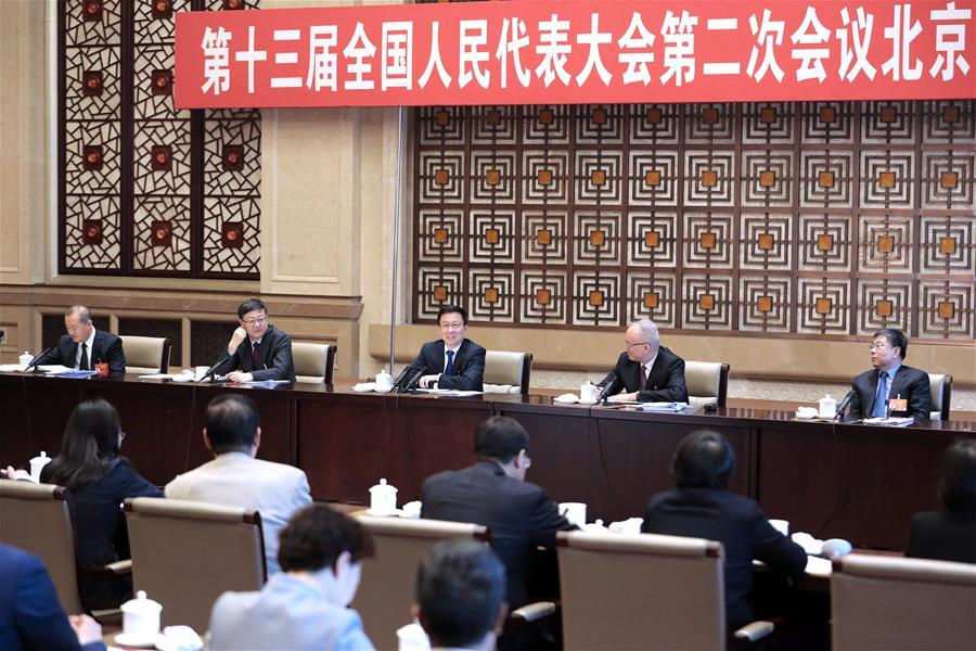 Chinese Vice Premier Han Zheng, also a member of the Standing Committee of the Political Bureau of the Communist Party of China (CPC) Central Committee, joins deliberation of the Beijing delegation at the second session of the 13th National People\'s Congress in Beijing, capital of China, March 8, 2019. (Xinhua/Liu Bin)