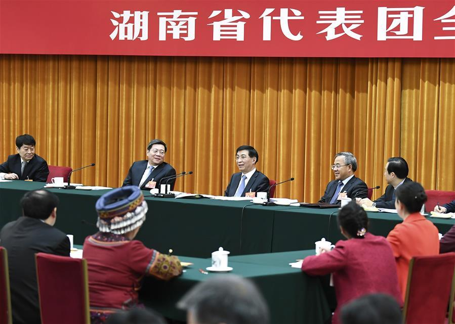 Wang Huning, a member of the Standing Committee of the Political Bureau of the Communist Party of China (CPC) Central Committee and a member of the Secretariat of the CPC Central Committee, joins deliberation with deputies from Hunan Province at the second session of the 13th National People\'s Congress in Beijing, capital of China, March 8, 2019. (Xinhua/Yan Yan)