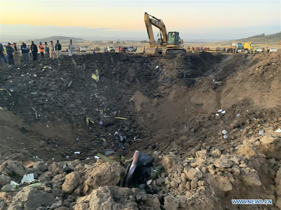 An excavator works at the crash site of an Ethiopian Airlines\' aircraft, some 50 km east of Addis Ababa, capital of Ethiopia, on March 10, 2019. All 157 people aboard Ethiopian Airlines flight were confirmed dead as Africa\'s fastest growing airline witnessed the worst-ever incident in its history. The incident on Sunday, which involved a Boeing 737-800 MAX, occurred a few minutes after the aircraft took off from Addis Ababa Bole International Airport to Nairobi, Kenya. It crashed around Bishoftu town, the airline said. (Xinhua/Wang Shoubao)