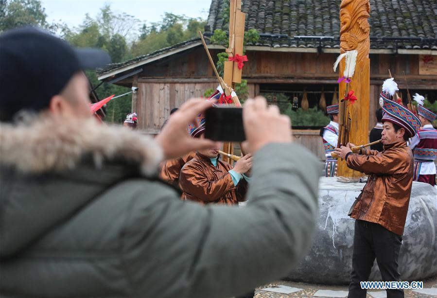 Pan Jiehui plays Lusheng, a reed-pipe wind instrument, in Rongshui Miao Autonomous County, south China\'s Guangxi Zhuang Autonomous Region, Jan. 15, 2019. China\'s efforts and success in poverty reduction can help other developing nations, said experts observing the country\'s ongoing Two Sessions. The Two Sessions refer to the annual gatherings of the National People\'s Congress (NPC) and the National Committee of the Chinese People\'s Political Consultative Conference, China\'s top legislature and political advisory body respectively. China has emerged as a global role model with efforts in structural transformation and industrial upgrading, lifting hundreds of millions of people out of poverty, said retired Lieutenant Colonel Muhammad Faruk Khan, a presidium member of Bangladesh\'s ruling Awami League. (Xinhua/Chen Junqing)