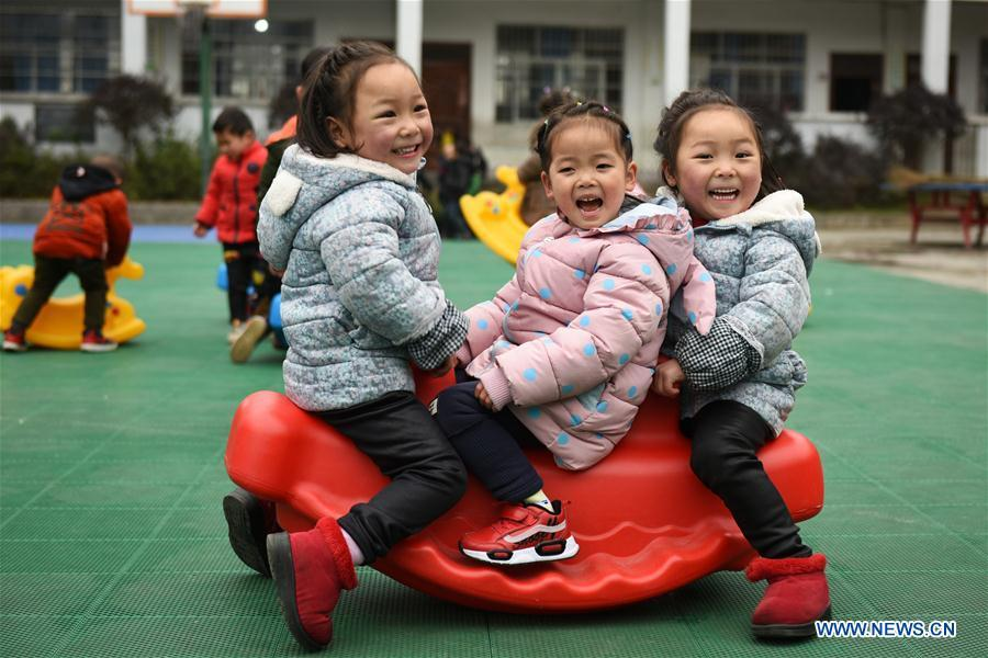 Huang Xingqi (1st R) and her twin sister Huang Xingyi (1st L) take part in outdoor activities at a kindergarten in Yuping Dong Autonomous County of Tongren, southwest China\'s Guizhou Province, Feb. 28, 2019. China\'s efforts and success in poverty reduction can help other developing nations, said experts observing the country\'s ongoing Two Sessions. The Two Sessions refer to the annual gatherings of the National People\'s Congress (NPC) and the National Committee of the Chinese People\'s Political Consultative Conference, China\'s top legislature and political advisory body respectively. China has emerged as a global role model with efforts in structural transformation and industrial upgrading, lifting hundreds of millions of people out of poverty, said retired Lieutenant Colonel Muhammad Faruk Khan, a presidium member of Bangladesh\'s ruling Awami League. (Xinhua/Yang Wenbin)