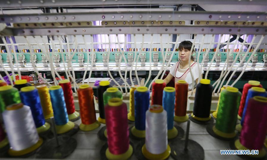 A staff member works on the production line at a toy company in Wuzhi County, central China\'s Henan Province, Aug. 11, 2018. China\'s efforts and success in poverty reduction can help other developing nations, said experts observing the country\'s ongoing Two Sessions. The Two Sessions refer to the annual gatherings of the National People\'s Congress (NPC) and the National Committee of the Chinese People\'s Political Consultative Conference, China\'s top legislature and political advisory body respectively. China has emerged as a global role model with efforts in structural transformation and industrial upgrading, lifting hundreds of millions of people out of poverty, said retired Lieutenant Colonel Muhammad Faruk Khan, a presidium member of Bangladesh\'s ruling Awami League. (Xinhua)