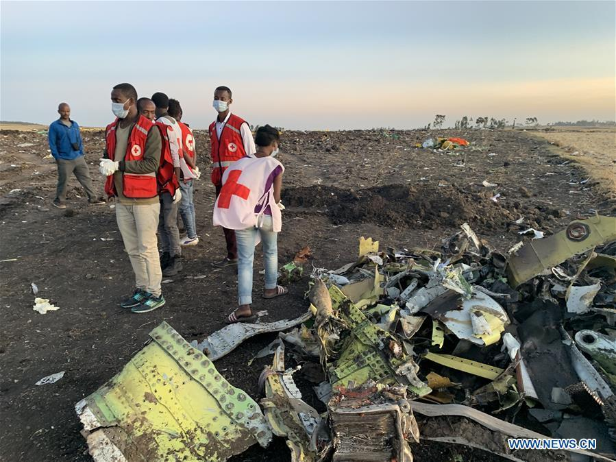 Rescuers work beside the wreckage of an Ethiopian Airlines\' aircraft at the crash site, some 50 km east of Addis Ababa, capital of Ethiopia, on March 10, 2019. All 157 people aboard Ethiopian Airlines flight were confirmed dead as Africa\'s fastest growing airline witnessed the worst-ever incident in its history. The incident on Sunday, which involved a Boeing 737-800 MAX, occurred a few minutes after the aircraft took off from Addis Ababa Bole International Airport to Nairobi, Kenya. It crashed around Bishoftu town, the airline said. (Xinhua/Wang Shoubao)