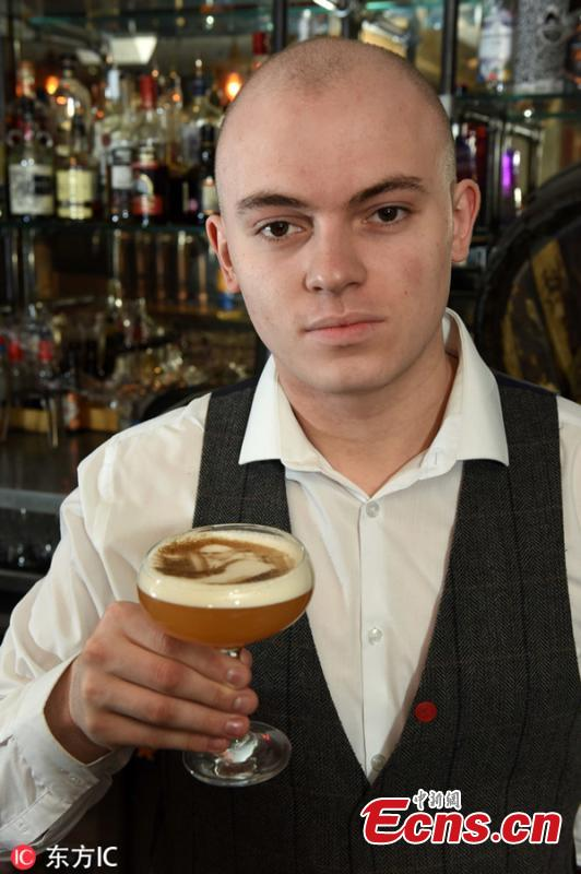 Matt Arnold, senior bar tender at the Canal House bar in Birmingham, with a porn star martini with his face printed on it. Bartenders at The Canal House in Birmingham city centre use a 3D printer to superimpose any image onto the foam atop an espresso, coffee or even a pint of Guinness. Staff said mainly selfies are chosen to adorn the boozy treat - which costs 8.95 - although they have had some more unusual requests.(Photo/Agencies)