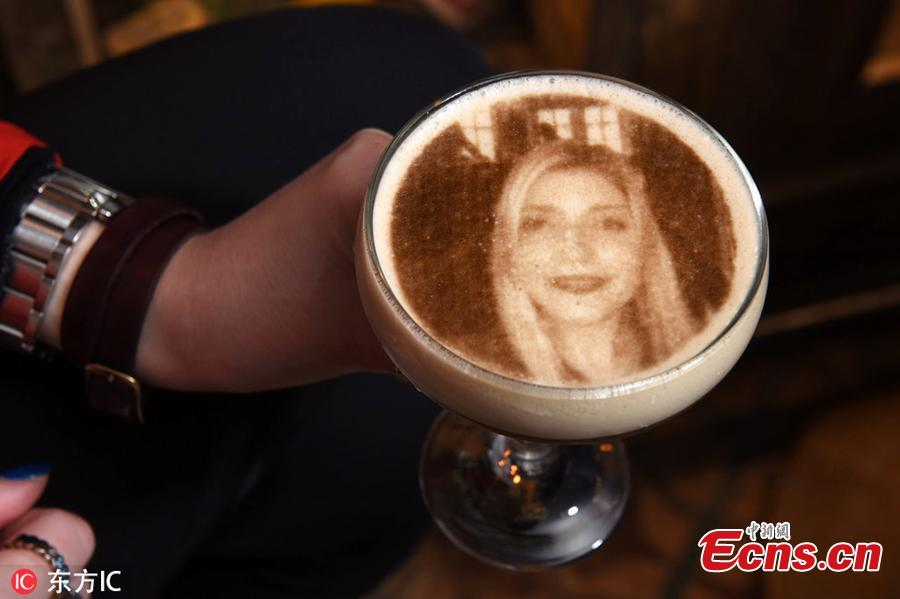 A customer demonstrates the process off uploading a selfie to the system and having it printed onto a cocktail at the bar. Bartenders at The Canal House in Birmingham city centre use a 3D printer to superimpose any image onto the foam atop an espresso, coffee or even a pint of Guinness. Staff said mainly selfies are chosen to adorn the boozy treat - which costs 8.95 - although they have had some more unusual requests.(Photo/Agencies)